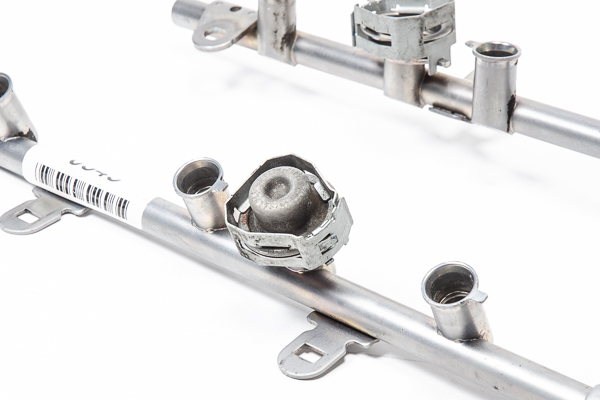 An OEM fuel rail with pulse damper